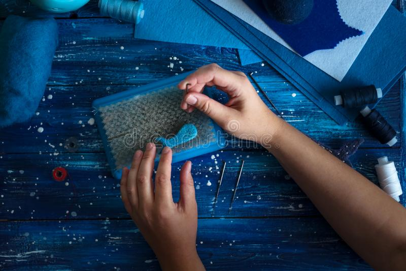 Bakgrund med handfeltingvalet från ull fotografering för bildbyråer