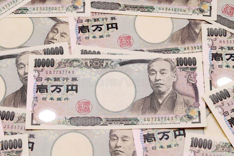 Bakgrund med japanska pengar royaltyfria bilder