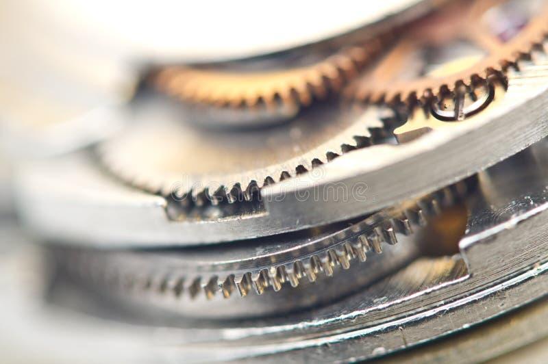 Bakgrund med metallkugghjulhjul Makro arkivfoton