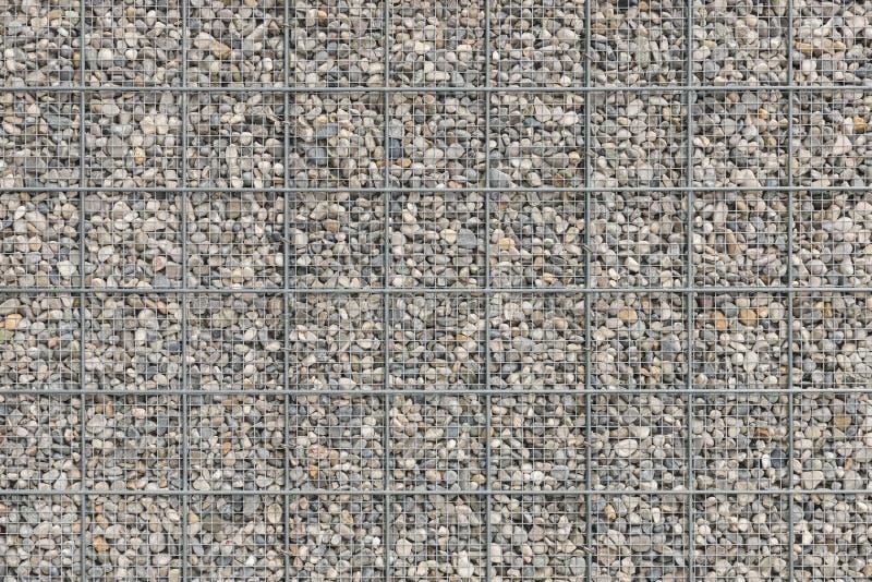 Bakgrund med mycket textur för kiselstengrusstenar arkivfoton