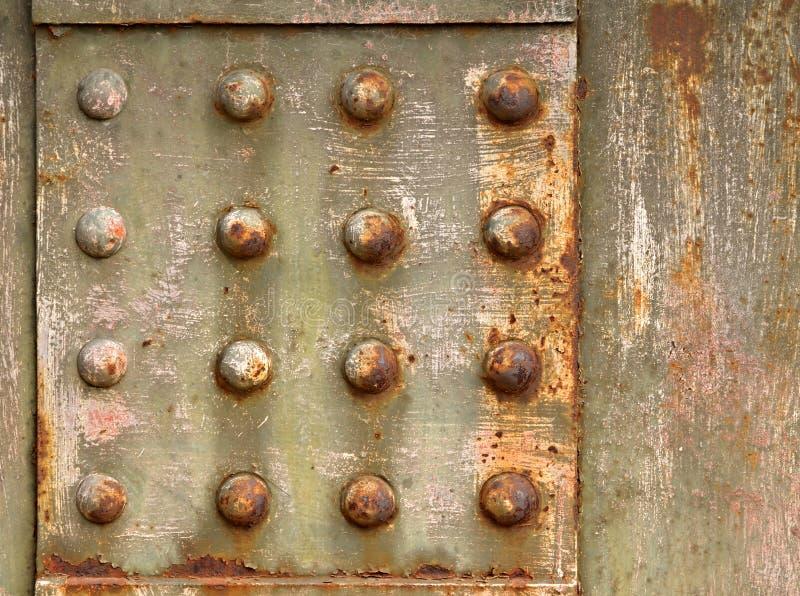 Bakgrund med stålnitar royaltyfri foto