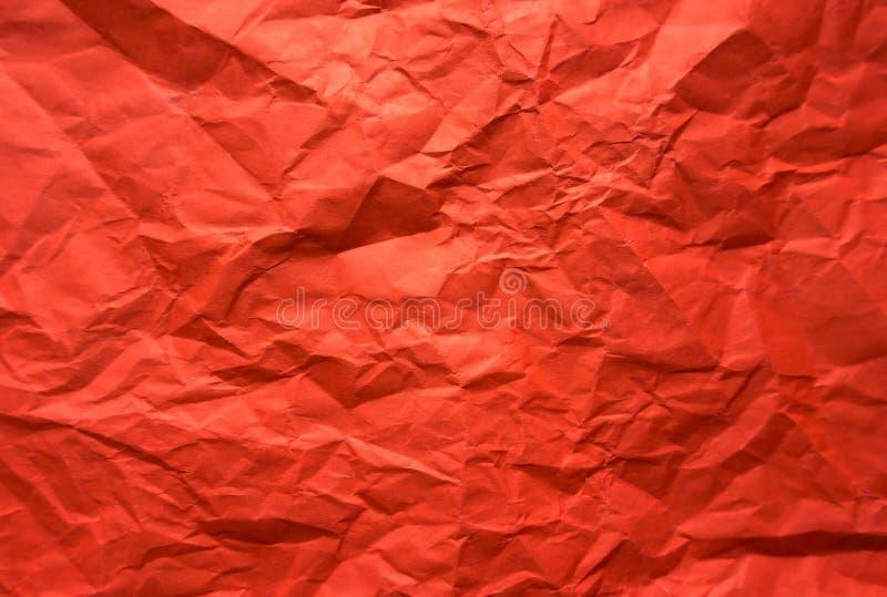 Bakgrund Skrynkligt rött ark av papper arkivfoto