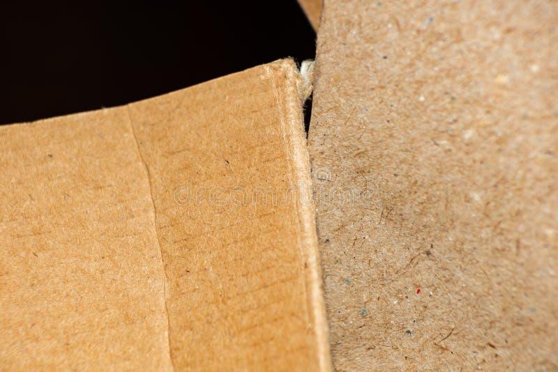Bakgrund som göras av papp- och hantverkpapper arkivfoton