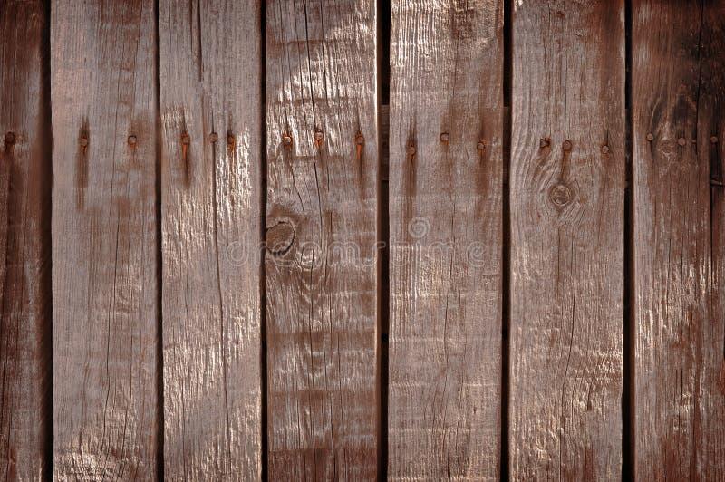 bakgrund som stiger ombord inomhus trä för brunt fragment Gamla bräden sjaskigt trä för bakgrund royaltyfria foton