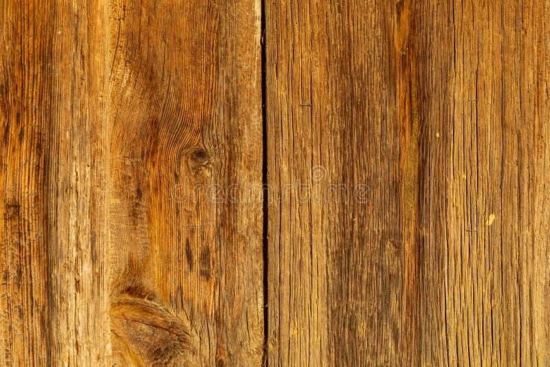 Bakgrund Texturen av de gamla träslatsna Guld- färg Bakgrund Texturen av de gamla träslatsna Guld- och ockra Co royaltyfria bilder