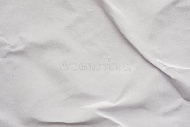 Bakgrund till vit, krumlad och skuren pappersaffischstruktur royaltyfri foto
