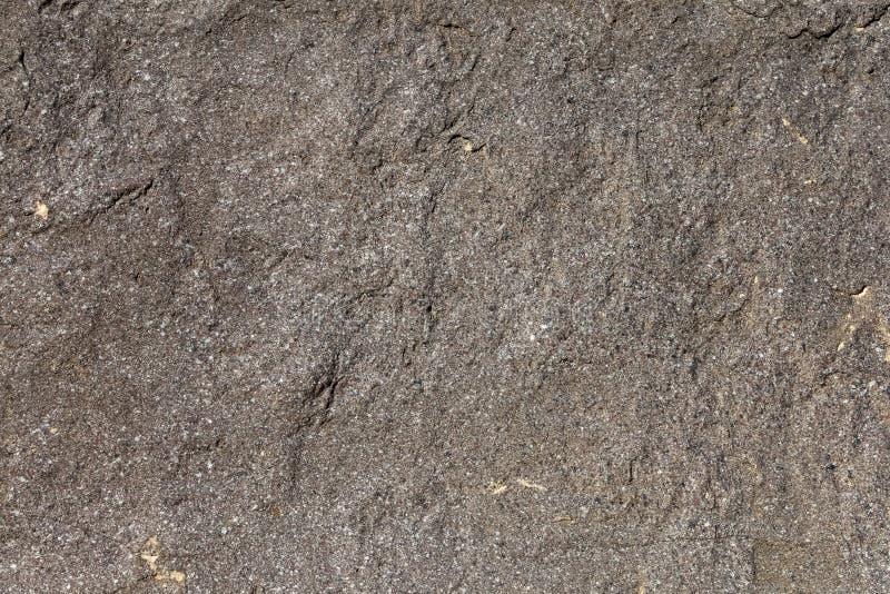Bakgrund ytbehandlar textur av granit vaggar royaltyfri bild