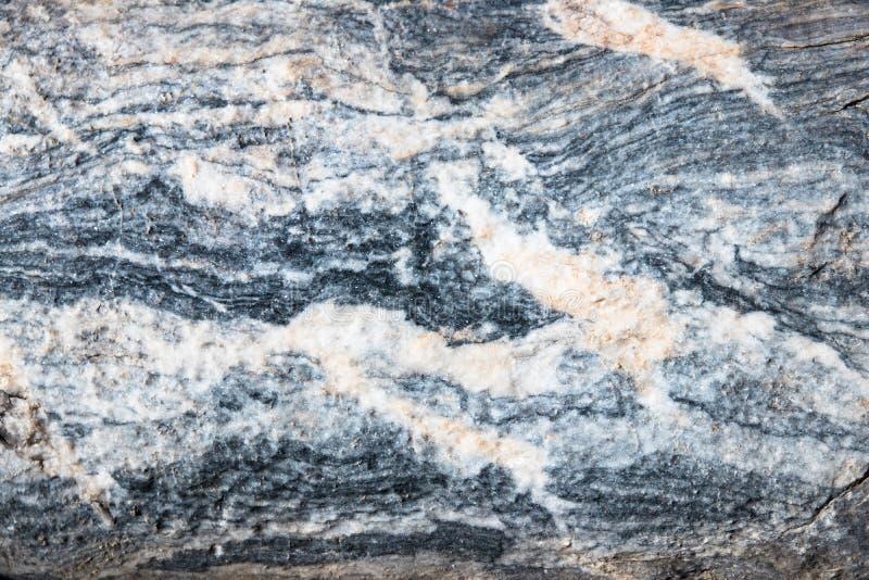 Bakgrunden är en naturlig plattaKarar marmor arkivfoton