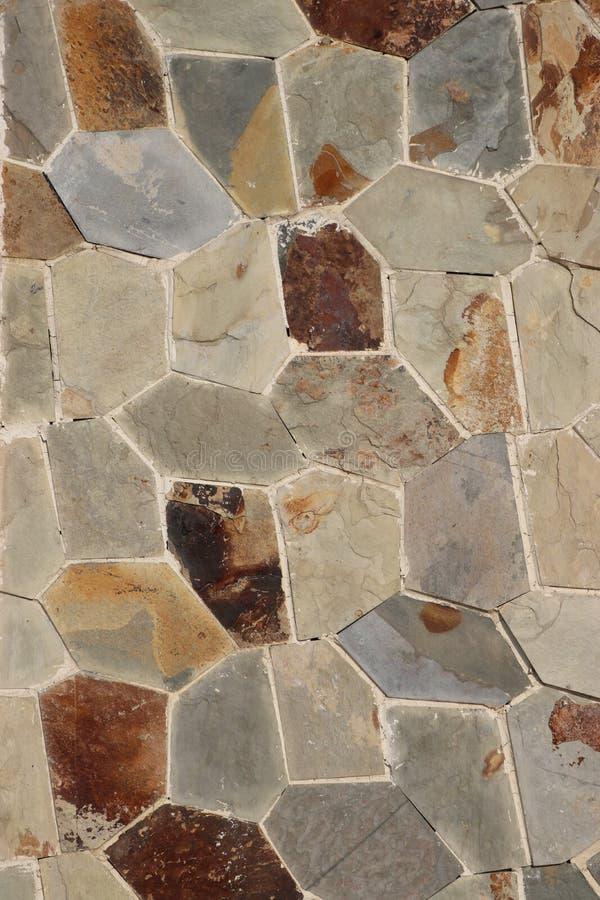 Bakgrunden av den stavade stenen royaltyfria bilder