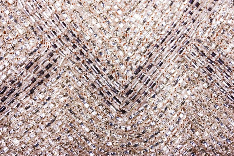 bakgrunden med mycket litet exponeringsglas kärnar ur pärlor Högt upplösningsfoto royaltyfria bilder
