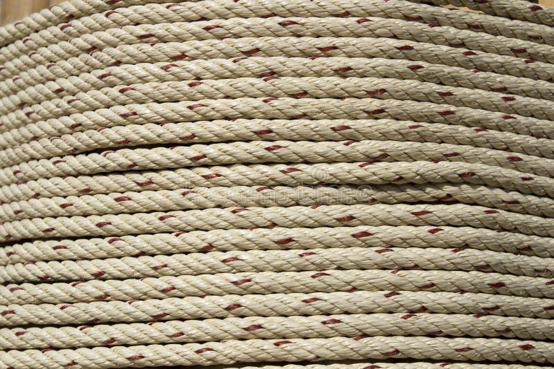 Bakgrunden till repet rullas runt i en cirkel royaltyfri foto