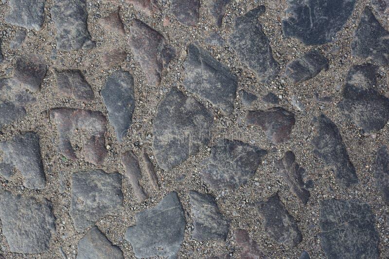 Bakgrunder som textureras - abstrakt gammalt trottoarkvarter royaltyfria bilder