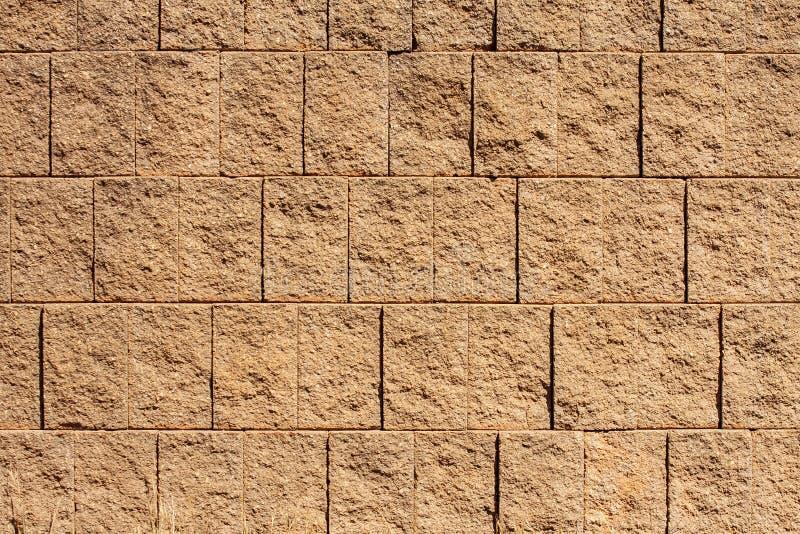 bakgrundsblockbrown textures väggen arkivbilder