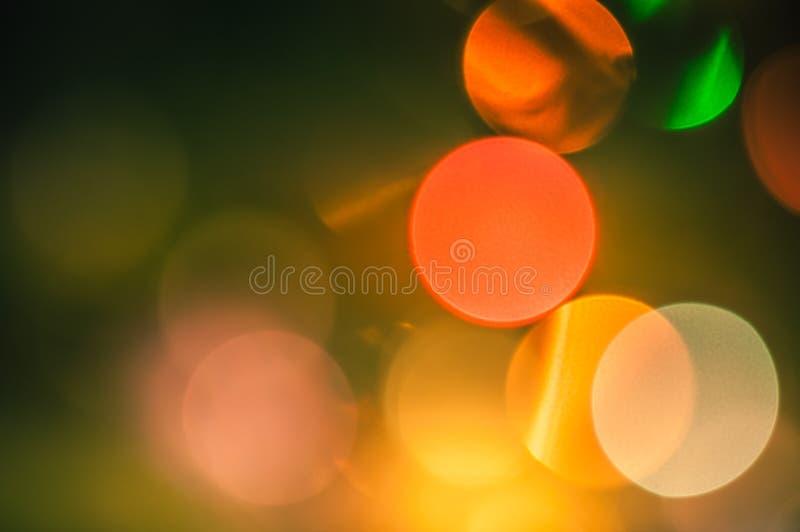 Bakgrundsbokeh färgade ljusa nytt års- och julcirklar arkivfoton