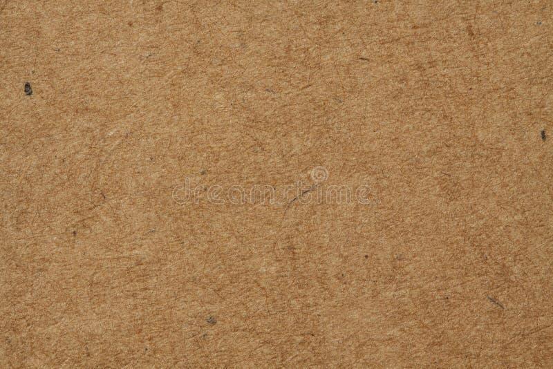 Bakgrundscloseup av den bruna pappers- asken arkivfoto