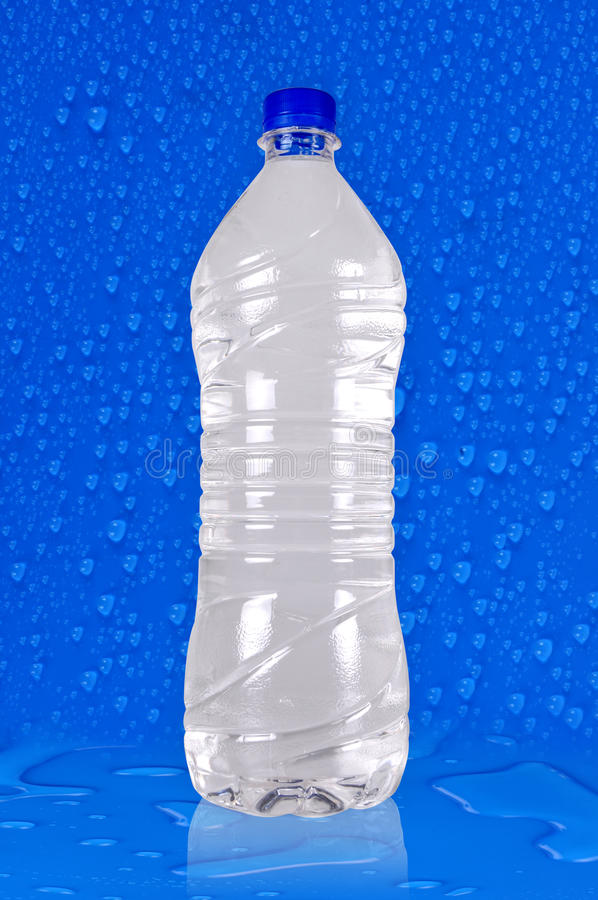 bakgrundsflaskvatten arkivfoto