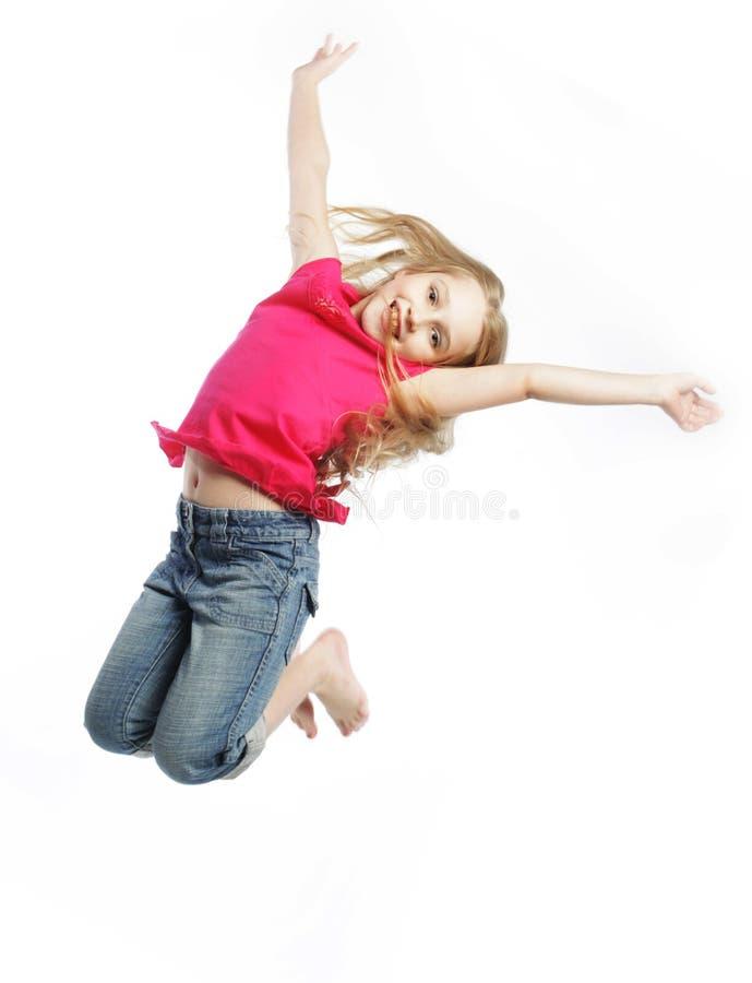 bakgrundsflickan hoppar white royaltyfri fotografi