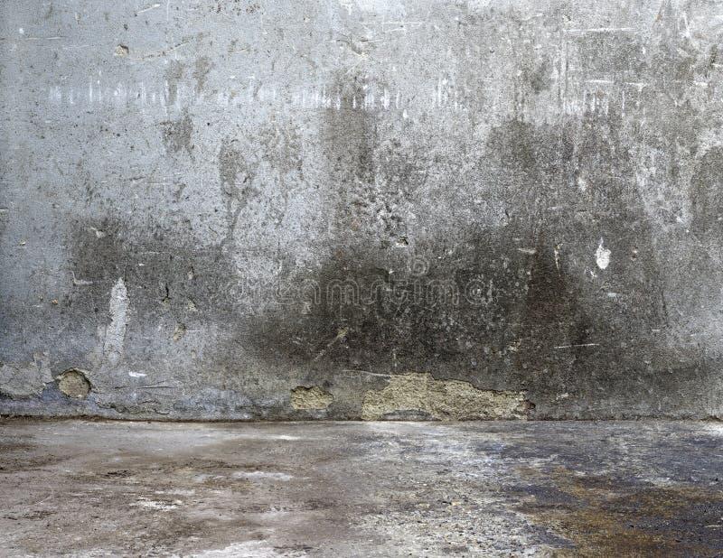 Bakgrundsgrå färg hårdnar strukturerar väggen royaltyfria foton