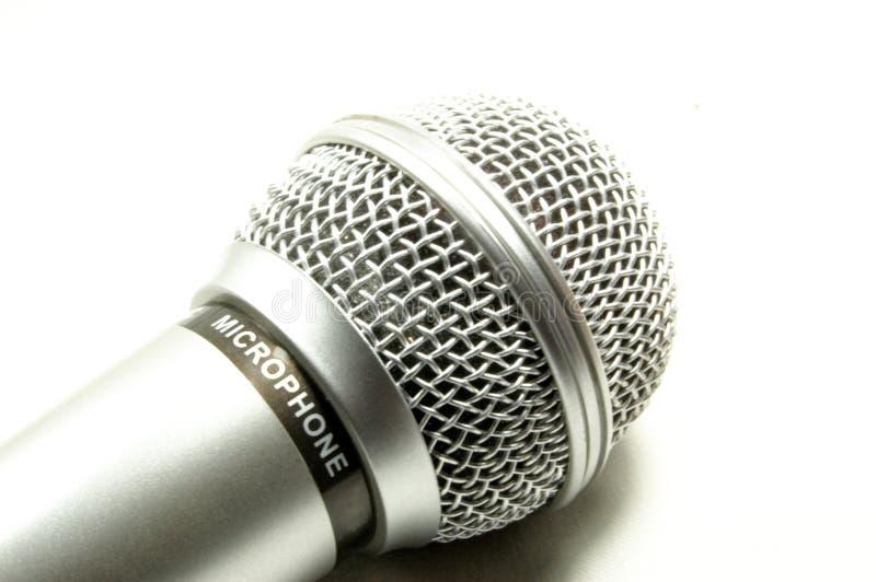 bakgrundsmikrofonwhite royaltyfri bild