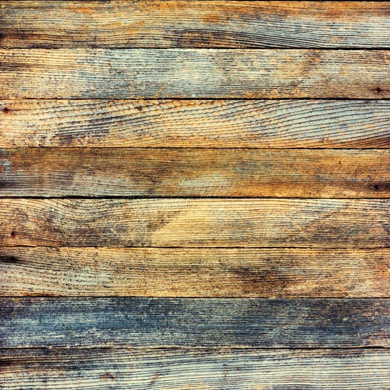 Bakgrundstextur av en gammal träladugård stiger ombord med retro toning arkivfoto