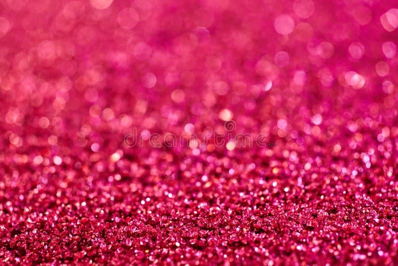 Bakgrundstextur av färgrika rosa färger blänker arkivbild