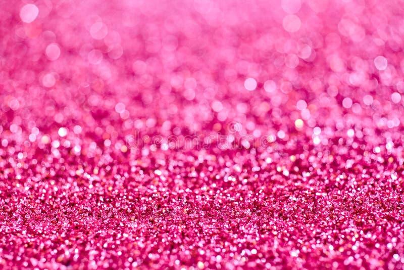 Bakgrundstextur av mousserande rosa färger blänker royaltyfri bild