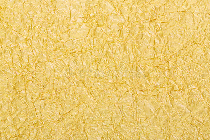 Bakgrundstextur för guld- folie fotografering för bildbyråer
