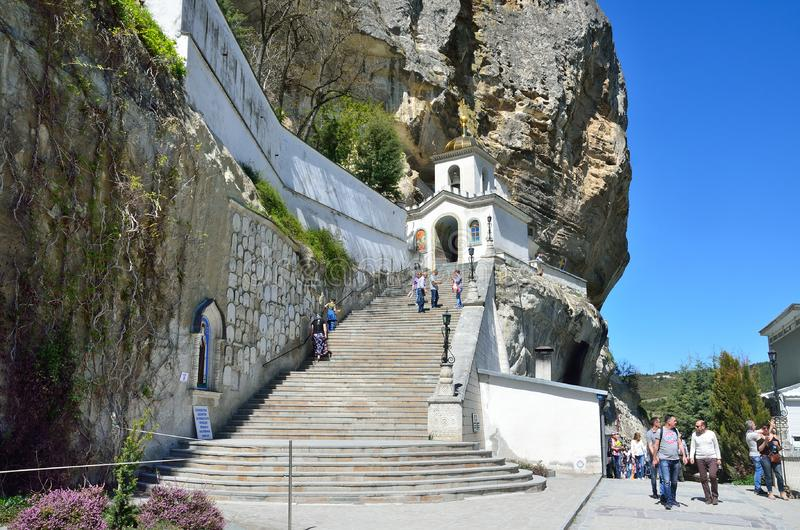 Bakhchisaray, Crimea, Russia, April, 29, 2017. People walking near cave monastery of the Holy assumption Svyato-Uspensky monaste. Bakhchisaray, Crimea, Russia stock image