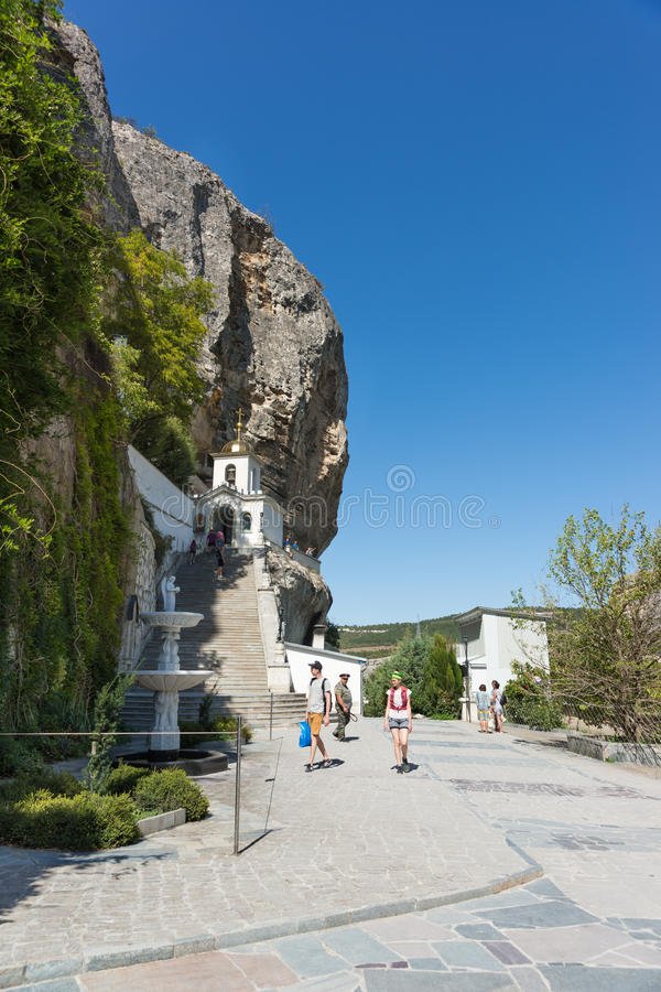 BAKHCHYSARAY, CRIMEA, RUSSIA - SEPTEMBER 13.2016: The current bell tower of the Holy Dormition cave monastery in the natural bound. Ary of Mariam-Dere Canyon of royalty free stock photo