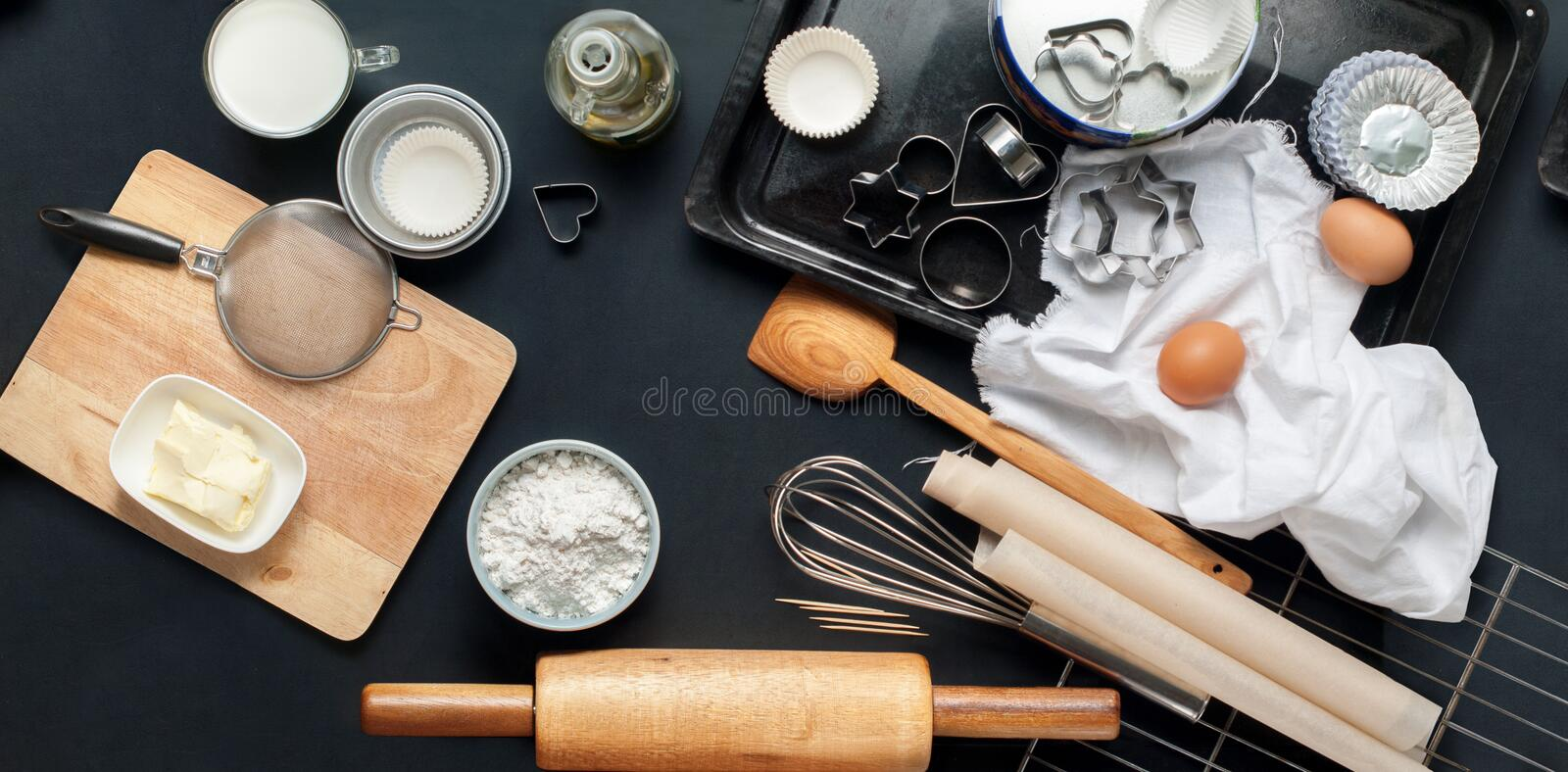 Baking Accessories Kitchen Black Table Top Wooden. Preparation Baking Accessories Kitchen Composition Black Table Top Wooden Metal Dishes Table Ware Fresh stock image