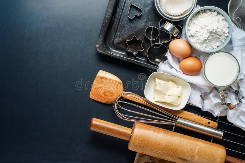 Baking Accessories Kitchen Composition Black Top. Preparation Baking Accessories Kitchen Composition Black Table Top Wooden Metal Dishes Table Ware Fresh Grocery royalty free stock photography