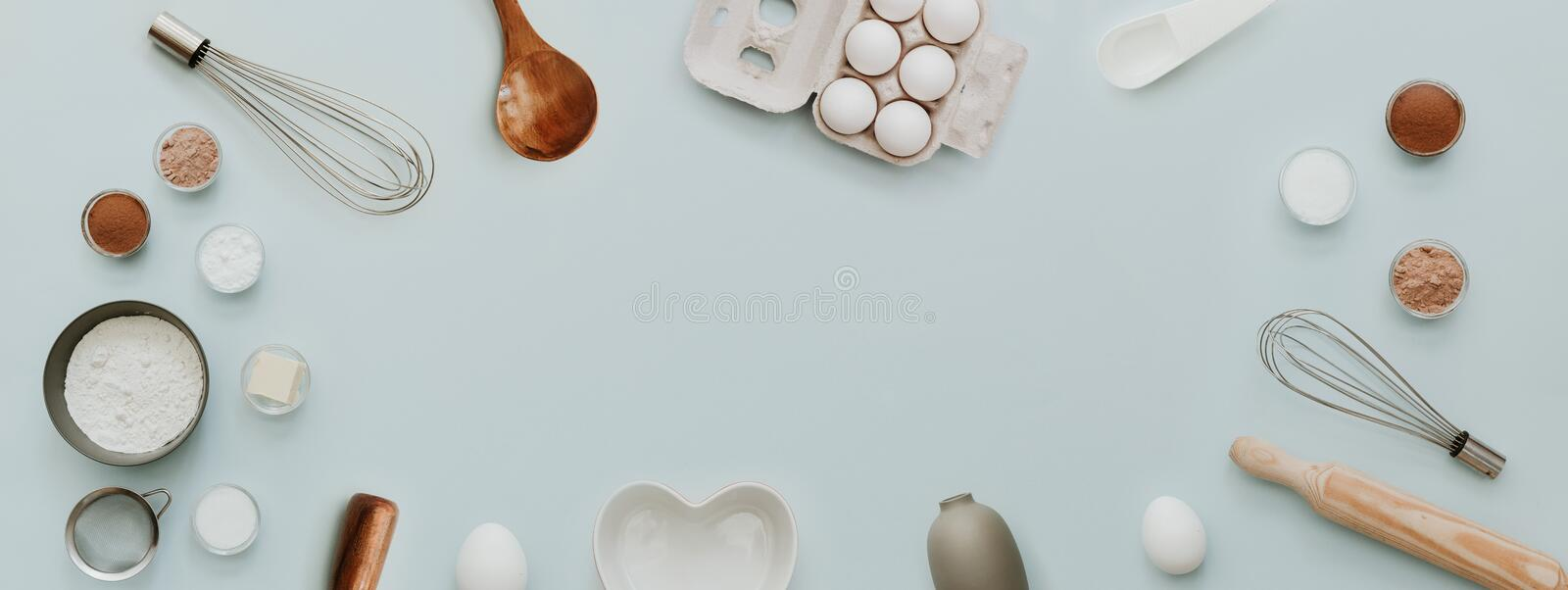 Baking background with bake ingredients, banner for website on pastel background, top view royalty free stock image