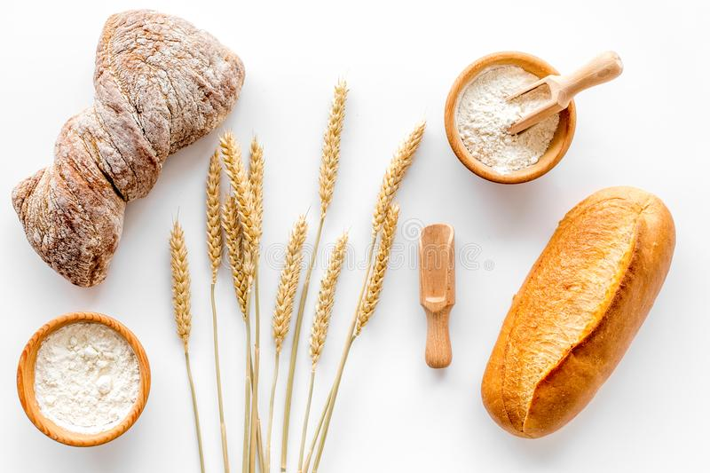 Baking bread with wheat flour and ears on table white background top view royalty free stock image