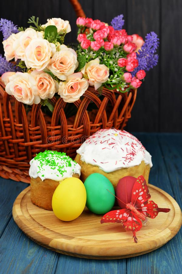 Baking cake with icing glaze bread with eggs in a basket colored stock photo
