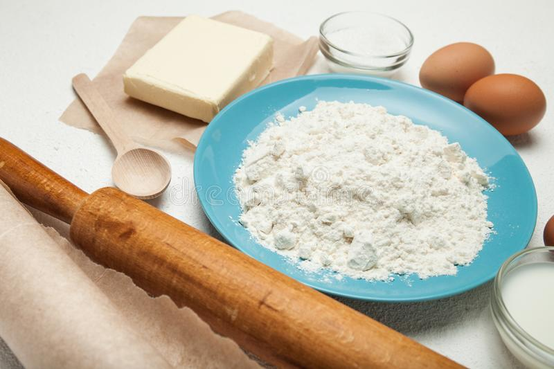 Baking cake, cake recipe, ingredients - eggs, flour, butter, sugar on the table. The concept of sweet cake.  stock image