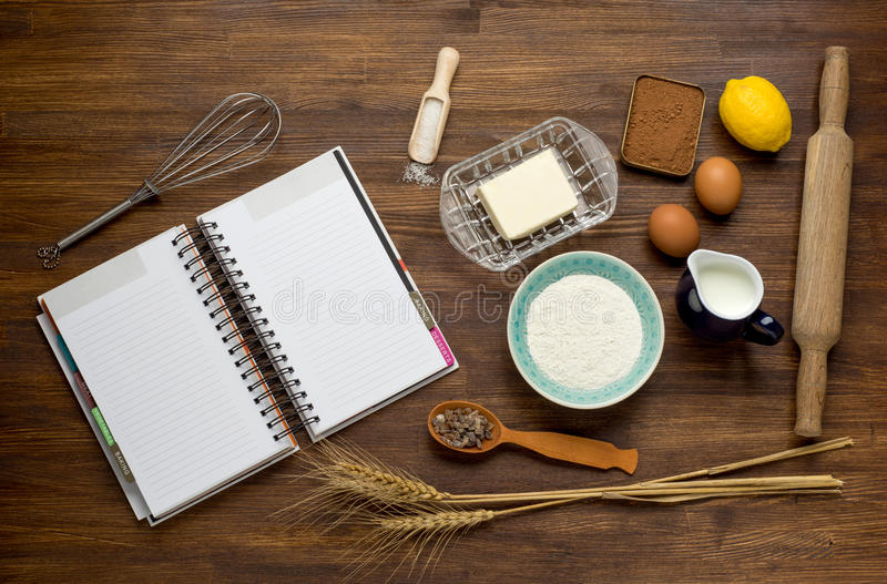 Baking cake in rural kitchen - dough recipe. Ingredients (eggs, flour, milk, butter, sugar) on vintage wooden table from above. Background layout with free text stock photos