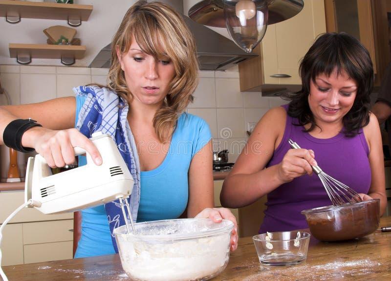 Download Baking cakes together stock photo. Image of feminine, kitchen - 1424492