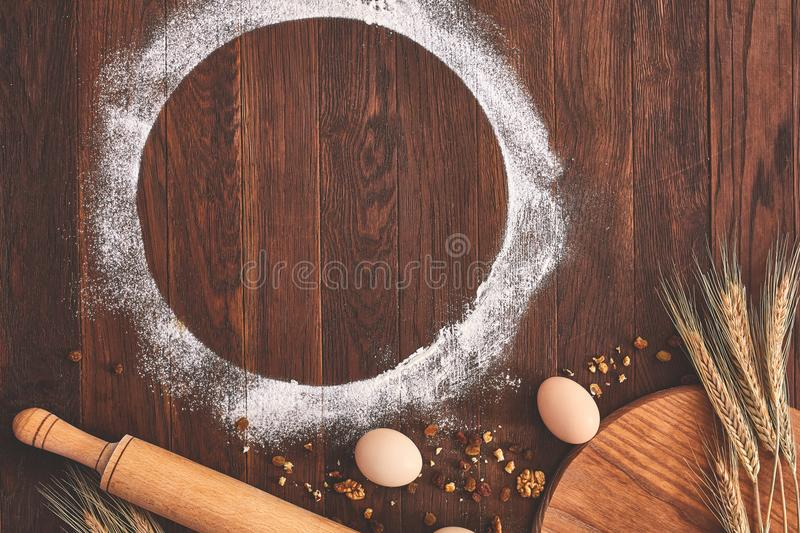 Baking chocolate cake in rural or rustic kitchen. Dough recipe ingredients on vintage wood table. From above royalty free stock images