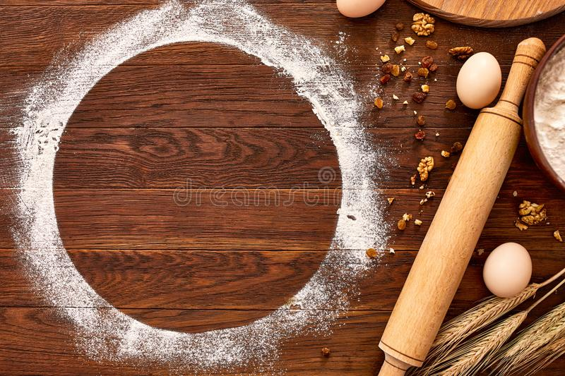 Baking chocolate cake in rural or rustic kitchen. Dough recipe ingredients on vintage wood table. From above stock images