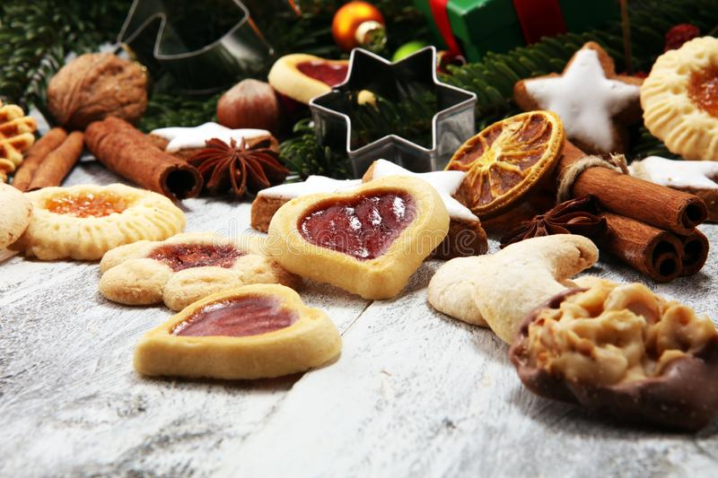 Baking christmas cookies. Typical cinnamon stars bakery for xmas with ingredients royalty free stock photography