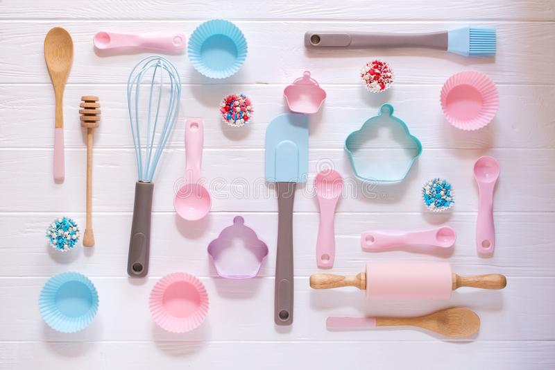 Baking and cooking concept. Pattern made of cookie cutters, whisk, roller pin and kitchen bake tools for making sweets. White background. Top view of a holiday royalty free stock photo