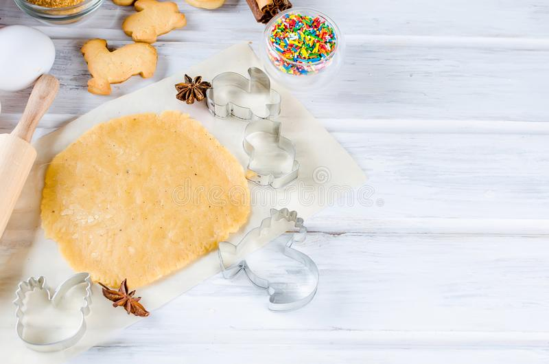 Baking Easter cookies, holiday cooking backgrounds stock photo