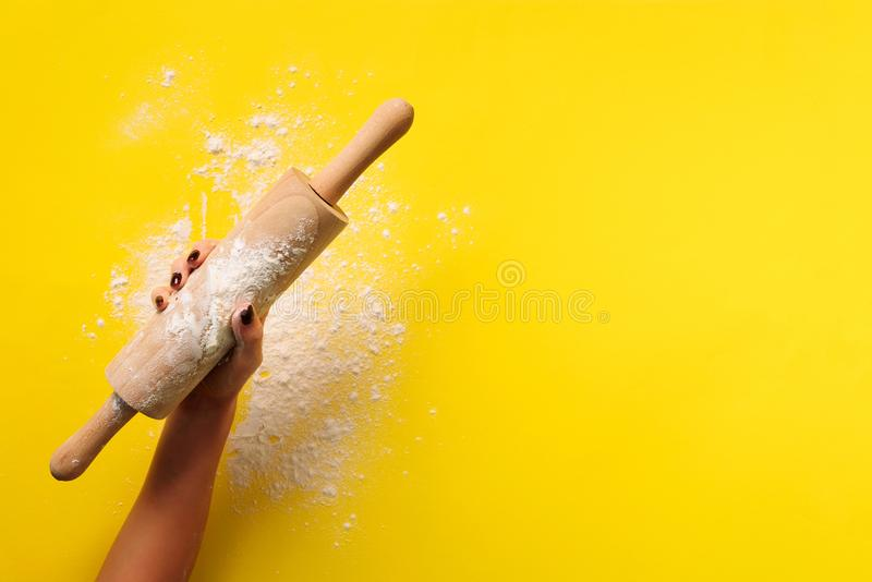 Baking flat lay with rolling pin, flour on yellow paper background. Bake menu, recipe, homemade pastry concept. Top view. Banner stock photos