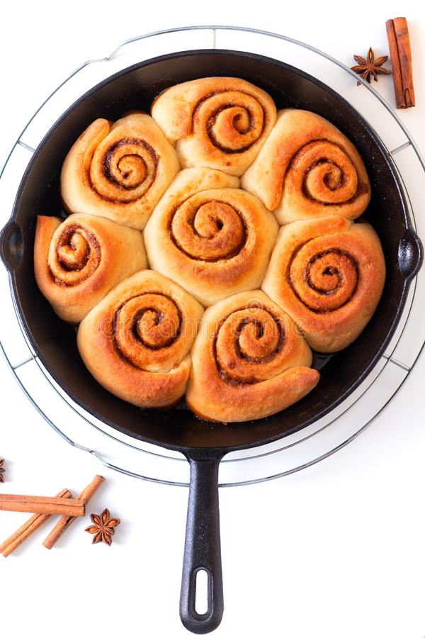 Baking food concept fresh baked homemade cinnamon rolls in skillet iron pan on white background royalty free stock photo