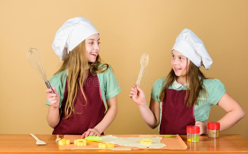 Baking ginger cookies. Girls sisters having fun ginger dough. Homemade cookies best. Kids baking cookies together. Kids stock photo