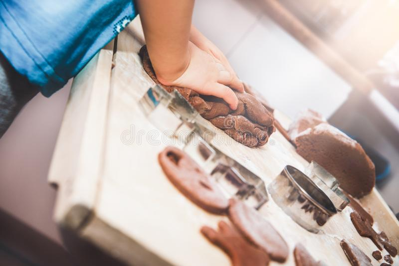 Baking gingerbreads. The family is preparing a gingerbread. royalty free stock photography