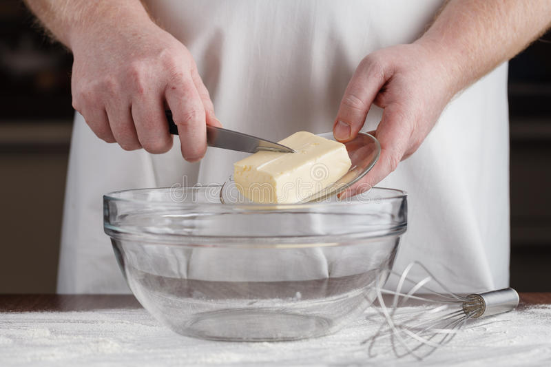Baking: Hand Cuts Into Butter With Ingredients to Make Muffins S stock photography