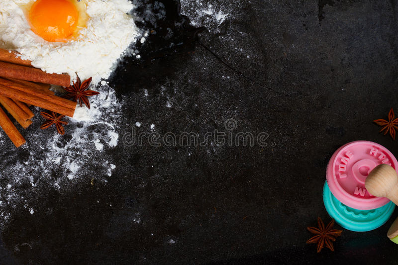 Baking ingredients on black. Raw baking ingredients on black background with copy space royalty free stock photo