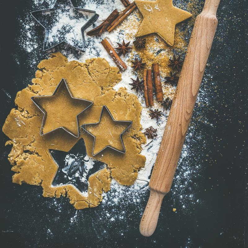 Baking ingredients for Christmas holiday traditional gingerbread cookies preparation, black background stock photos