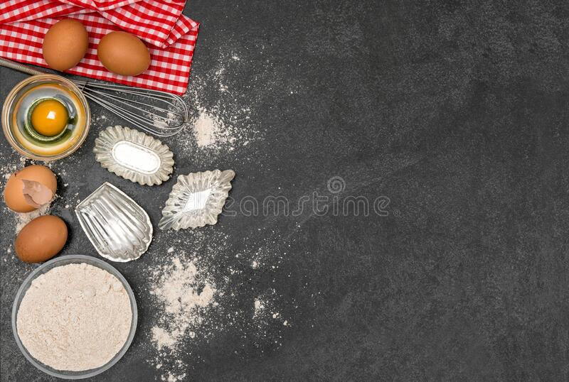 Baking ingredients dough Flour eggs cookie forms stock photography